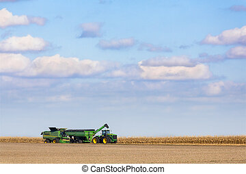 Harvest Time - A green combine harvester and farm tractor ...