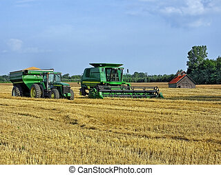 Harvest Time - Modern farming equipment in a winter wheat...