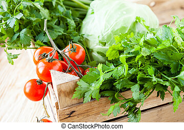 Harvest vegetables in a wooden box