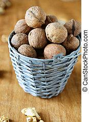 harvest walnuts in a wicker bucket