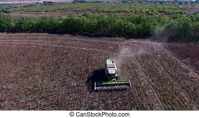 Harvester Collects Sunflowers. Aerial Survey 4K DJI Phantom...
