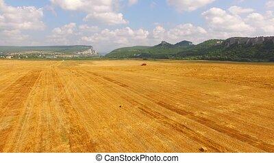 Harvester Combine Working In The Field