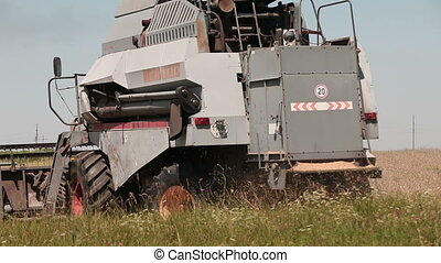 harvester in the field day unfolds