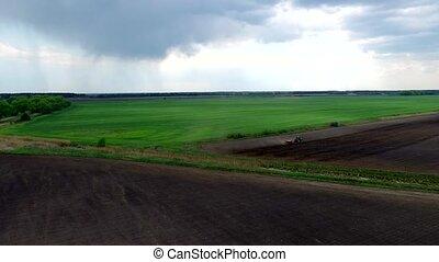 harvester plowing field in spring