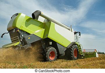 harvesting combine in field