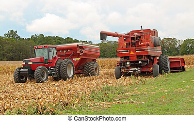 Harvesting Corn - Farm combine and a tractor and wagon...