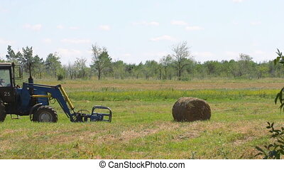 Tractor loading hay