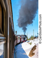 Harz national park Germany, Steam train on the way to Brocken through winter landscape, Famous steam train throught the winter mountain . Brocken, Harz National Park Mountains in Germany