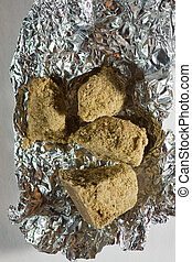 Hashish in solid form, a drug made from Marijuana from water extraction.