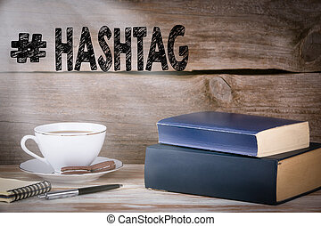 Hashtag. Stack of books on wooden desk