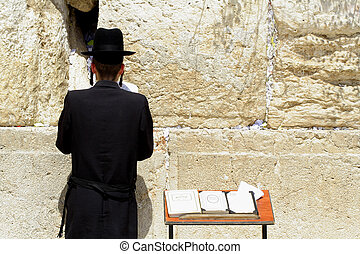 Hasidic jew at the wailing western wall, jerusalem, israel