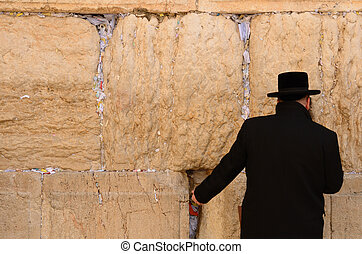 Jerusalem, Israel - February 17, 2012: A hassidic Jew prays at the wailing wall in the Old City.