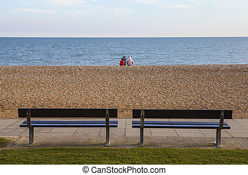 Hastings Seafront - Sitting on the pebbled beach along the...
