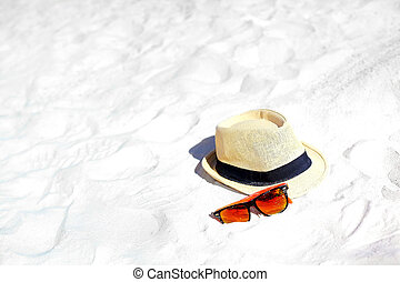 Hat and colorful sunglasses on summer beach white sand