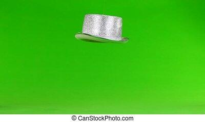 hat flies on a green screen