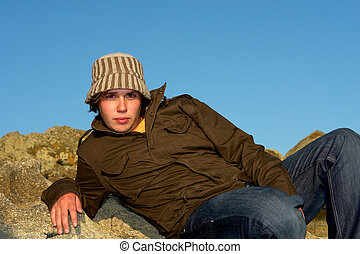 hat man - relaxed young man portrait outdoor with a hat