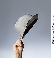 Hat - Man tipping his vintage trilby hat.