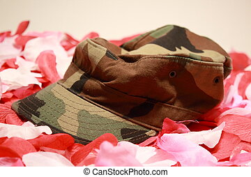 Hat - Military cover on rose pedals. Military cover on rose...