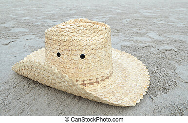 Hat on tropical island beach