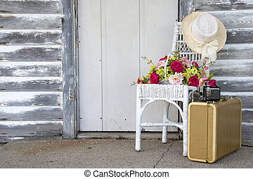 hat on wicker chair with flowers