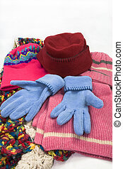 hat, scarf and gloves on white background