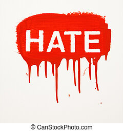 Hate painted on wall. - Hate painted on wall in red with...
