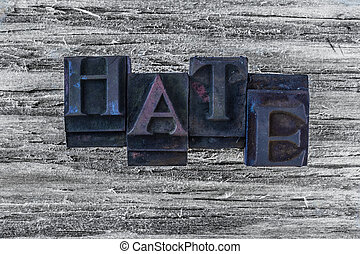 hate word on wooden background