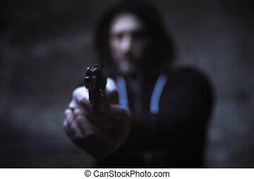 Hateful street hooligan aiming his gun for someone