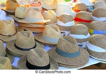Hats arrangement on market hand craft shop in rows