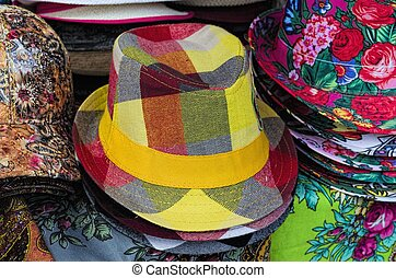Hats - Colorful female summer hats lie on the counter