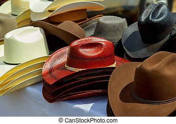 Hats for sale in a street market.