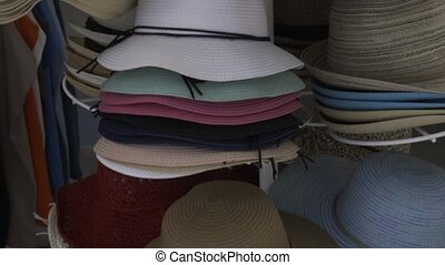 Hats in outdoor store stacked in a row - Hats in the outdoor...