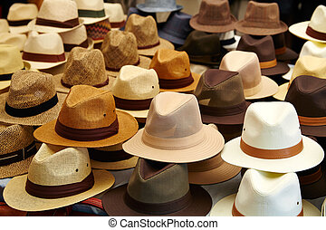 Hats in outdoor store stacked in rows - Hats in outdoor...