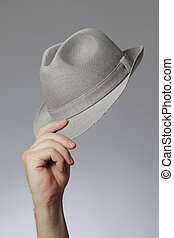 Man holding a vintage trilby hat in his hand