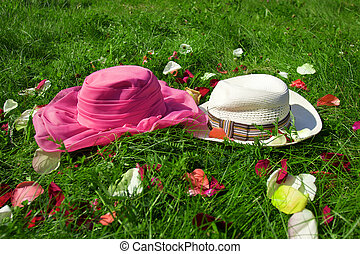 Hats on the green grass background