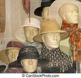 Hats shop window aspect with different mannequins wearing ...