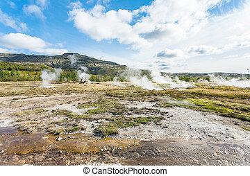Haukadalur geyser valley in Iceland in autumn - travel to...
