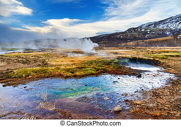 Haukadalur landscape - The colorful geyser landscape at the...
