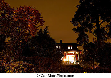 Haunted House - A house with spooky lighting, taken late at...