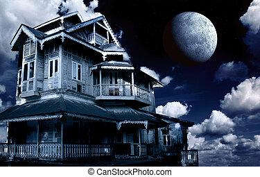 Haunted house. Old abandoned house on night sky background