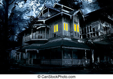 Haunted house. Old abandoned house with lighted windows