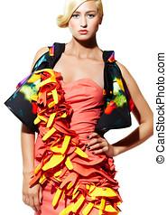 Haute Couture - Beautiful woman wearing orange dress.