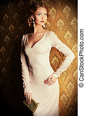 haute couture dress - Elegant young woman in evening dress...