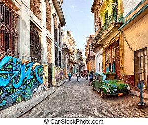 HAVANA, CUBA-MAY 14: Street scene with an old rusty american...