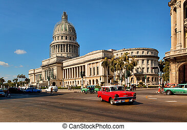 HAVANA, CUBA-MAY 14:Vintage cars near the Capitol on May 14,2013 in Havana. These old cars, the only ones that could be bought until last year, are a famous sight on the streets of the city