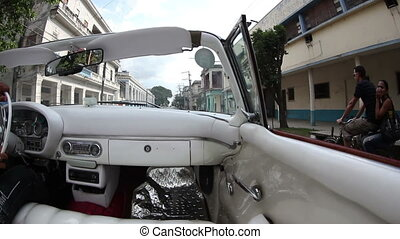havana street scene shot from a classic convertible car, ...