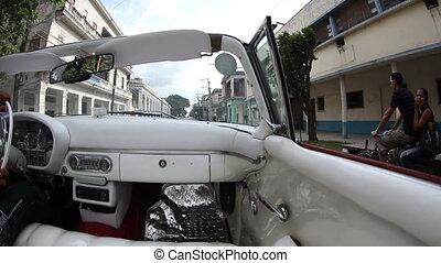 havana street scene shot from a classic convertible car, ...