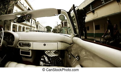 havana street scene shot from a classic convertible car,...