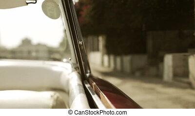 havana street scene shot from a classic convertible car,...