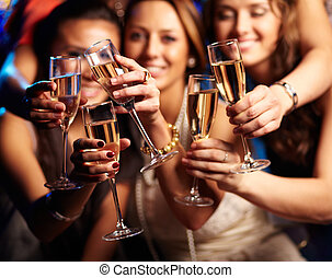 Have a drink - Group of partying girls clinking flutes with...